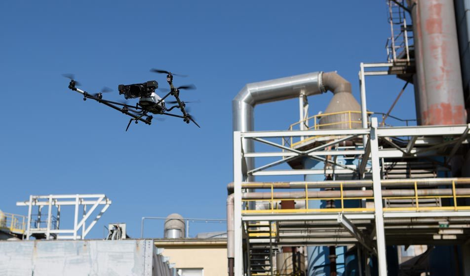 A drone by Bogensberger Vermessung / Surveys in front of the industrial plant of Donau Chemie in Pischelsdorf. The drone was used to do aerial inspection of the plant.