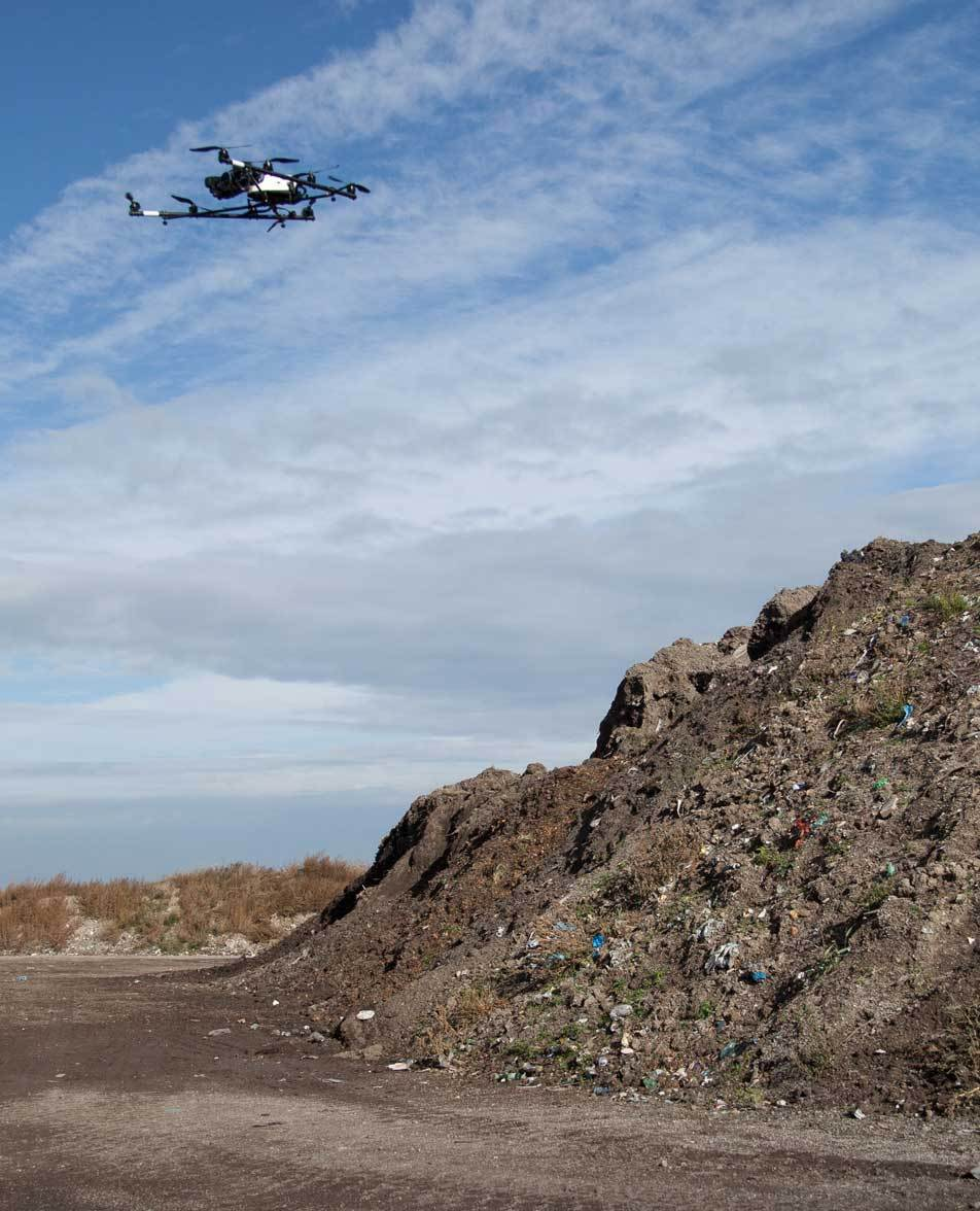 An Asctec Falcon 8 octocopter drone from Bogensberger Vermessung / Surveys flying over the MA 48 landfill Rautenweg.
