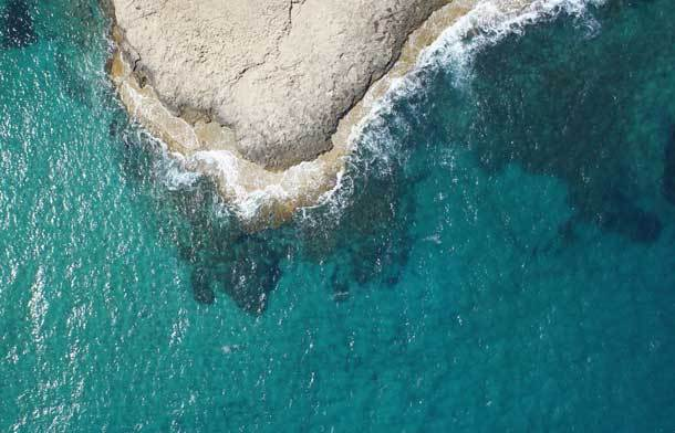 Aerial image of the coastline in Cyprus by a drone from Bogensberger Vermessung / Surveys.